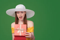 Woman opening gift box. Surprised summer style woman opening gift box Stock Photos