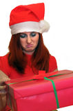 Woman opening gift disappointed and unhappy royalty free stock image