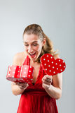 Woman opening the gift and is happy Stock Photo
