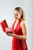 Woman opening the gift and is happy Stock Photos