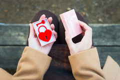 Woman opening gift with heart-shaped padlock.  Royalty Free Stock Photography