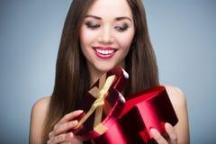 Woman opening heart shaped box Royalty Free Stock Image