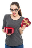 Woman opening heart shaped box Stock Images