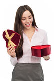 Woman opening heart shaped box Stock Photos