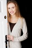 Woman opening her house door Royalty Free Stock Image