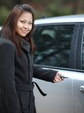 Woman opening her new car Stock Image