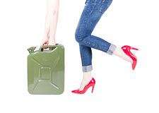 Woman opening jerrycan Royalty Free Stock Images