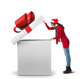 Woman opening a large present Stock Photo