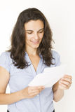 Woman opening a letter Royalty Free Stock Photography