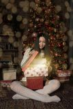 Woman opening magic gift box. stock images