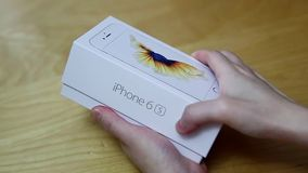Woman opening new iphone 6s at home stock video footage