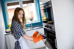 Woman opening the oven Royalty Free Stock Image