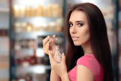 Woman Opening Perfume Bottle in Cosmetics Shop Stock Images