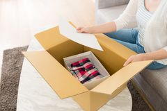 Woman Opening Personal Online Shopping Parcel Stock Image