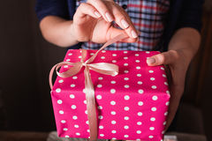 Woman opening pink gift box closeup Royalty Free Stock Images