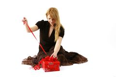 Woman Opening a Present Royalty Free Stock Photos