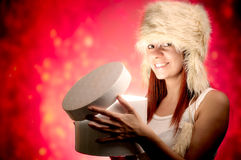 Woman opening present Stock Image