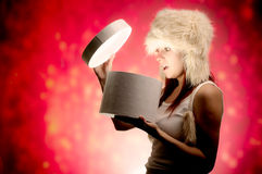 Woman opening present Royalty Free Stock Photos