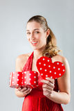 Woman opening present for valentines day. Woman opening heart shaped gift box with present for birthday or valentines day stock photos