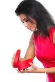 Woman opening red heart shaped gift box. Happiness, valentines day and love concept. Attractive elegant woman in red dress, girl mixed race opening red heart Stock Image