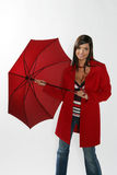 Woman opening red umbrella. Stock Images