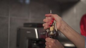 Woman is opening a red wine bottle using a cork opener. Hands close up - Business women leisure stock video footage