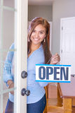 Woman Opening A Store Royalty Free Stock Photo