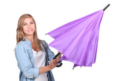 Woman opening an umbrella Stock Photos
