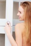 Woman opening wardrobe doors Royalty Free Stock Photography
