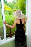 Woman opening window Royalty Free Stock Photo