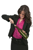 Woman Opening Wine Royalty Free Stock Image