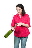 Woman Opening Wine Stock Image