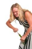 Woman Opening Wine Stock Photo