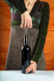 Woman opening wine bottle Royalty Free Stock Photo