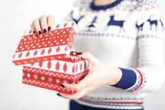 Woman opens a box of gifts Royalty Free Stock Image
