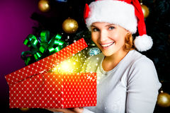 Woman opens the box with gifts on the christmas holiday Stock Photos