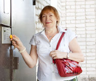 Woman opens the door Royalty Free Stock Photos