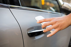 Woman opens her car with her mobile phone Royalty Free Stock Images