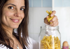 Woman opens pasta airtight jar Stock Photos