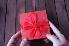 The woman opens the gift Royalty Free Stock Photo