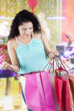 Woman opens shopping bags at the mall Royalty Free Stock Photography