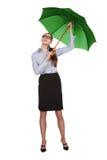 Woman opens an umbrella over his head. Young woman opens an umbrella over his head Stock Photography