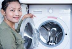 Woman opens washing machine Stock Photography