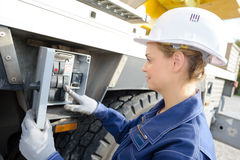 Woman operating controls on side crane Royalty Free Stock Photos