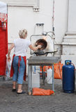 Woman Operating Nut Roasting and Glazing Machine Royalty Free Stock Photos