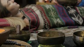 Woman operating with Tibetan singing bowls. yoga instructor conducts meditation. 4K stock video footage