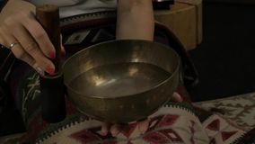 Woman operating with Tibetan singing bowls. yoga instructor conducts meditation. slow motion stock video