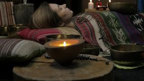 Woman operating with Tibetan singing bowls. yoga instructor conducts meditation. slow motion stock video footage