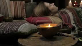 Woman operating with Tibetan singing bowls. yoga instructor conducts meditation. slow motion stock footage