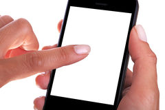 Woman operating touch screen phone Royalty Free Stock Images